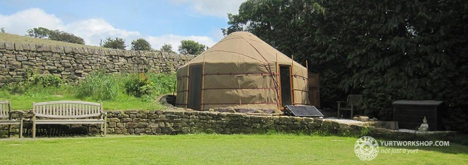 Sand coloured yurt with windoww
